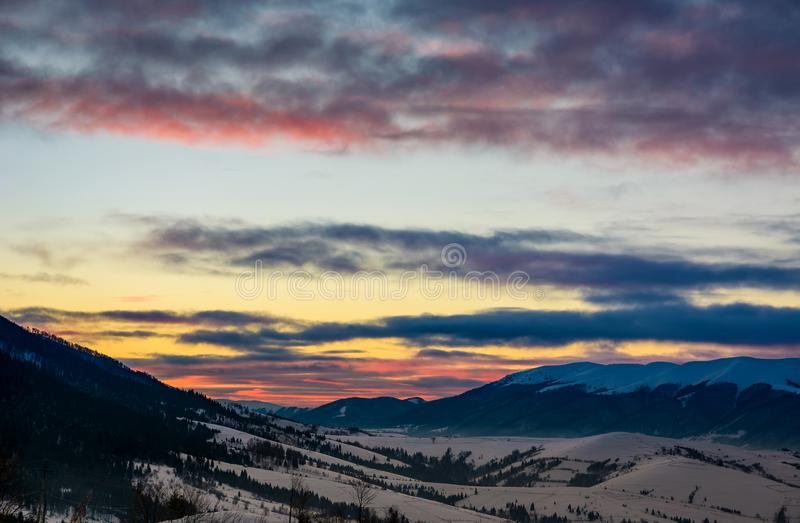 Gorgeous colorful clouds over the mountain ridge royalty free stock image
