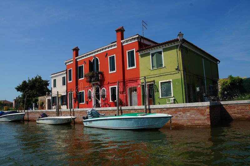 Boat trip in lagoon of Venice / colorful houses royalty free stock photography