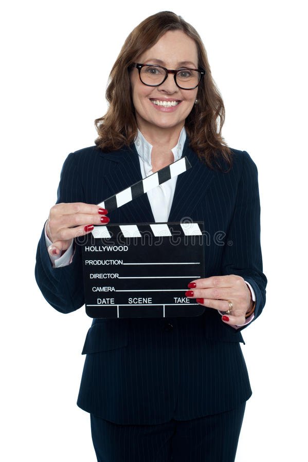 Download Gorgeous Corporate Woman Holding A Clapperboard Royalty Free Stock Photos - Image: 28422068