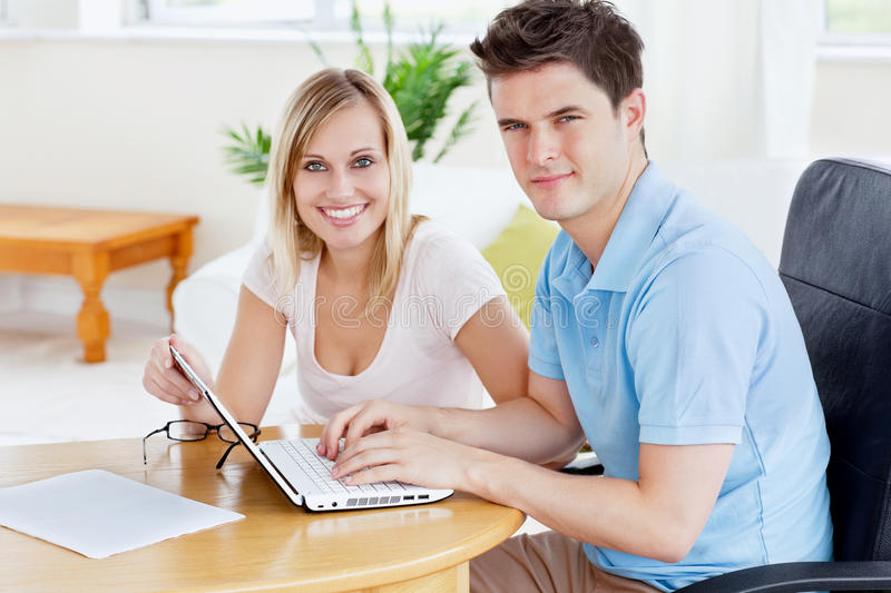 Download Gorgeous Couple Working Together On The Laptop Stock Image - Image: 16484263