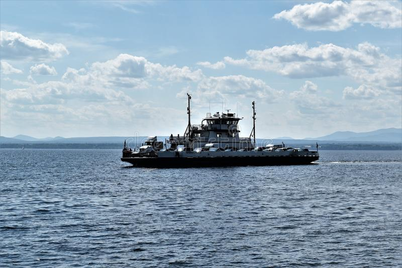 Ferry crossing  Lake Champlain, New York, United States, US. USA. A gorgeous day for a ferry ride on Lake Champlain, in upstate New York, United States. The royalty free stock image
