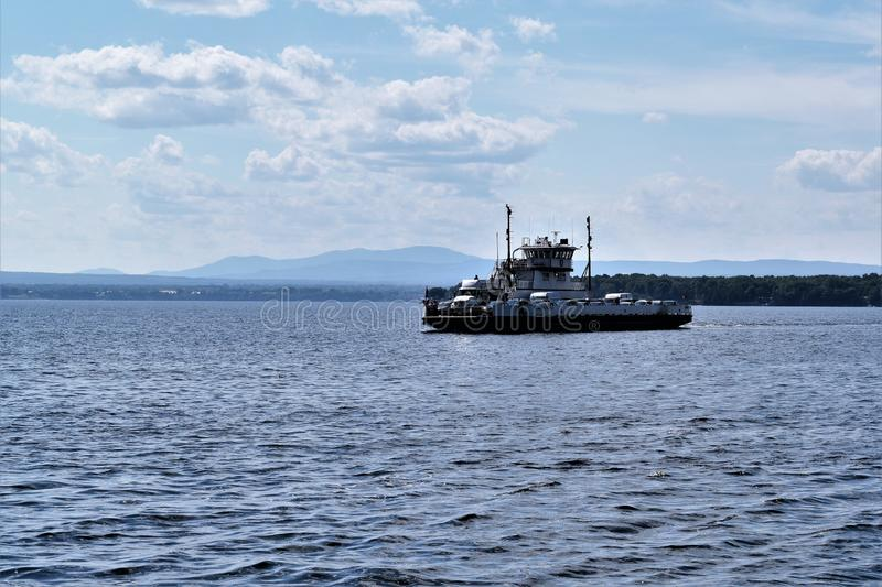 Ferry crossing  Lake Champlain, New York, United States, US. USA. A gorgeous day for a ferry ride on Lake Champlain, in upstate New York, United States. The stock photos
