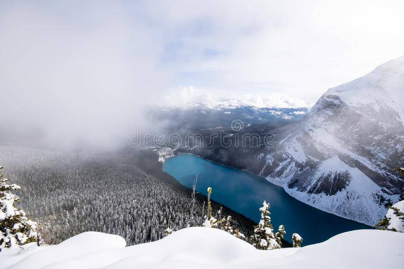 Lake Louise from Beehive hike in the winter. Gorgeous deep blue Lake Louise during winter from above in Canadian Rockies stock photos