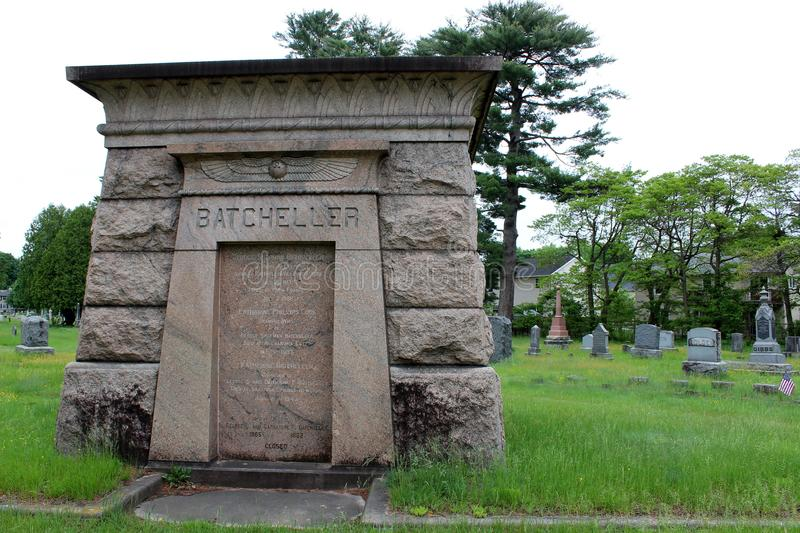 Beautiful mausoleum set among other headstones, green grass, and trees Greenridge Cemetery, Saratoga Springs, New York, 2018. Gorgeous detail in large stone stock image