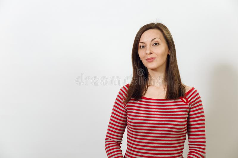 Pretty European happy brown-haired woman with healthy clean skin dressed in casual longsleeve on a white background stock photo