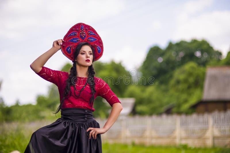 Gorgeous Fashion Brunete Woman In Russian Style Kokoshnik Outdoors. Horizontal Image Composition stock images