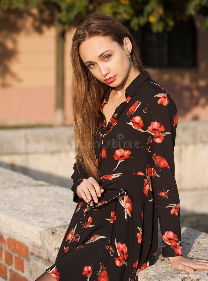 Gorgeous fashion brunette outdoors. royalty free stock photos