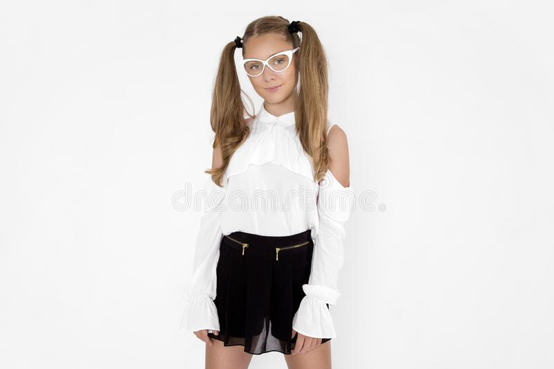 Gorgeous fashion young model schoolgirl with casual hairstyle wearing trendy glasses. Cool trendy eyewear portrait.Female fashion royalty free stock photo