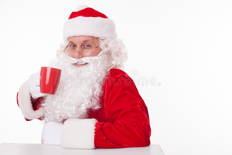 Gorgeous Father Christmas is resting after work stock photo