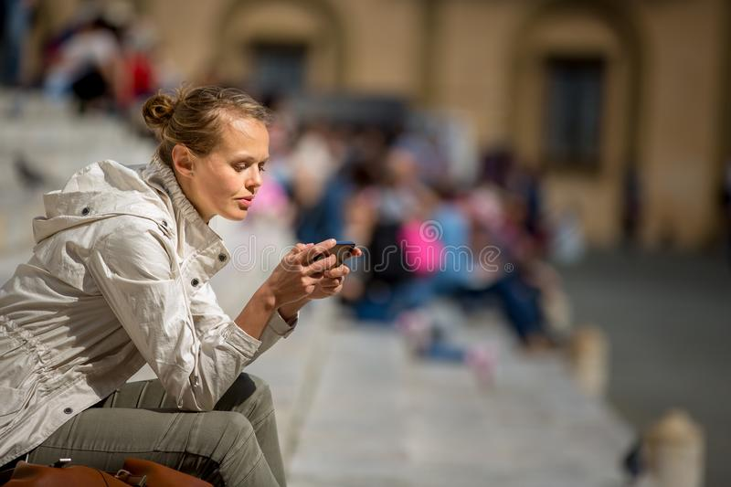 Gorgeous female tourist with a map discovering a foreign city s. Hallow DOF; color toned image stock image