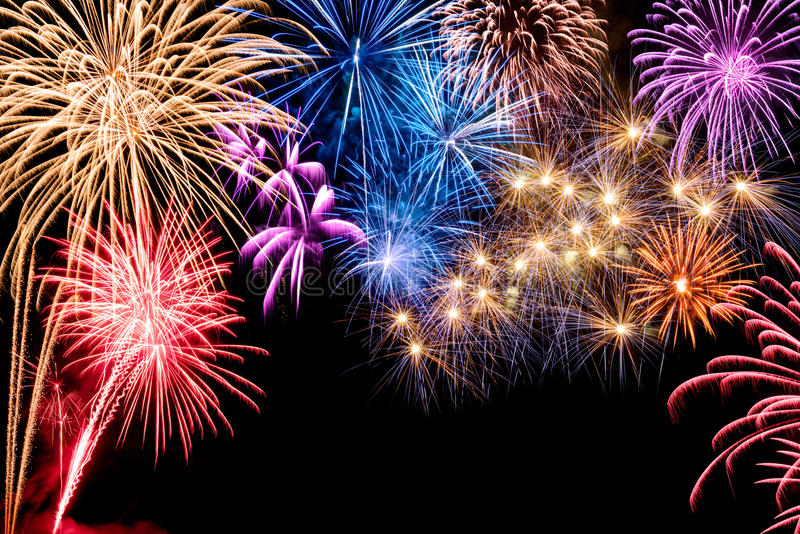 Gorgeous fireworks display. Gorgeous multi-colored fireworks display on black background, with copyspace royalty free stock photo