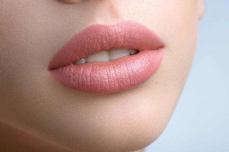 Gorgeous full lips of a beautiful woman stock photos