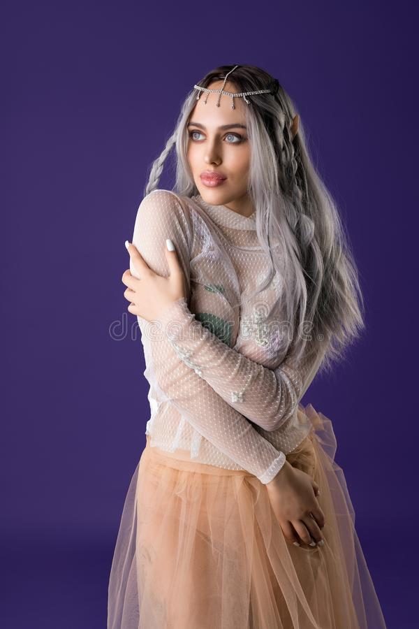 Gorgeous young girl in the image of elf shot royalty free stock photo