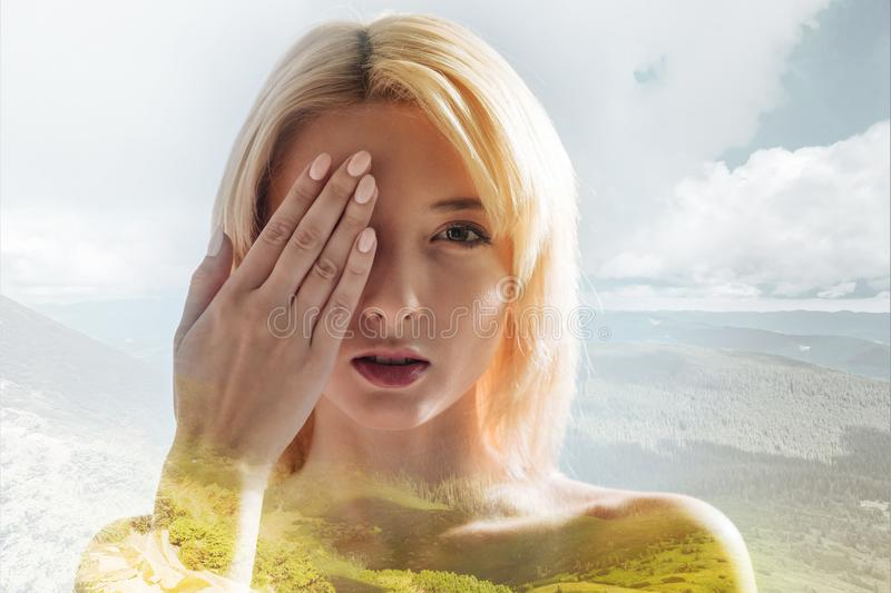 Gorgeous girl hiding half of face behind the hand royalty free stock photography