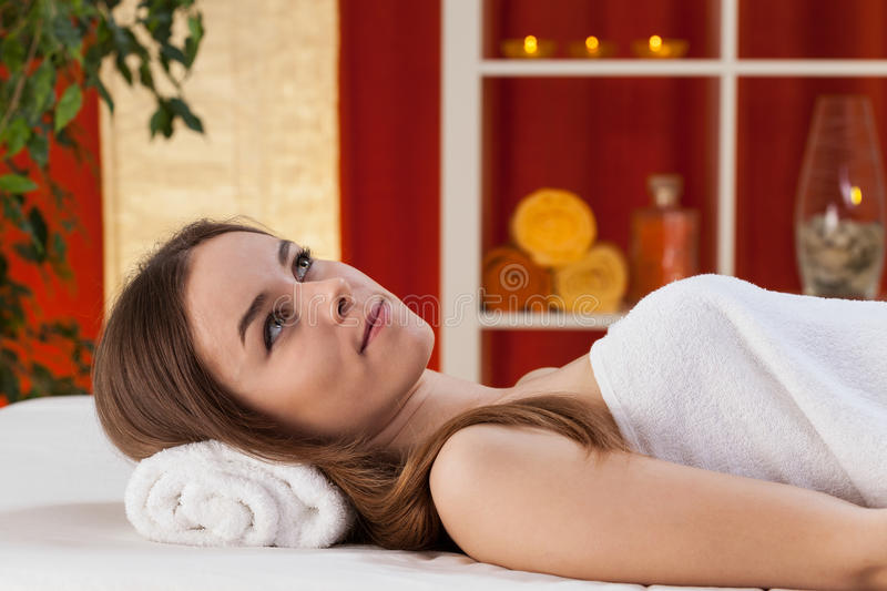 Gorgeous girl relaxing at spa stock image