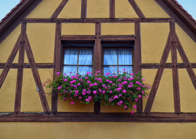 Gorgeous Half-Timbered House in Germany. A beautiful half-timbered building with gable roof in Rothenburg ob der Tauber. In the town district of Ansbach of royalty free stock photo