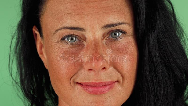 Gorgeous happy mature woman with beautiful eyes smiling to the camera royalty free stock photo