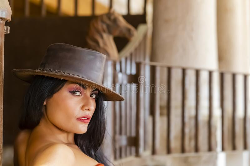 A Lovely Hispanic Brunette Model Poses With A Horse Outdoors In A Home Environment stock photo