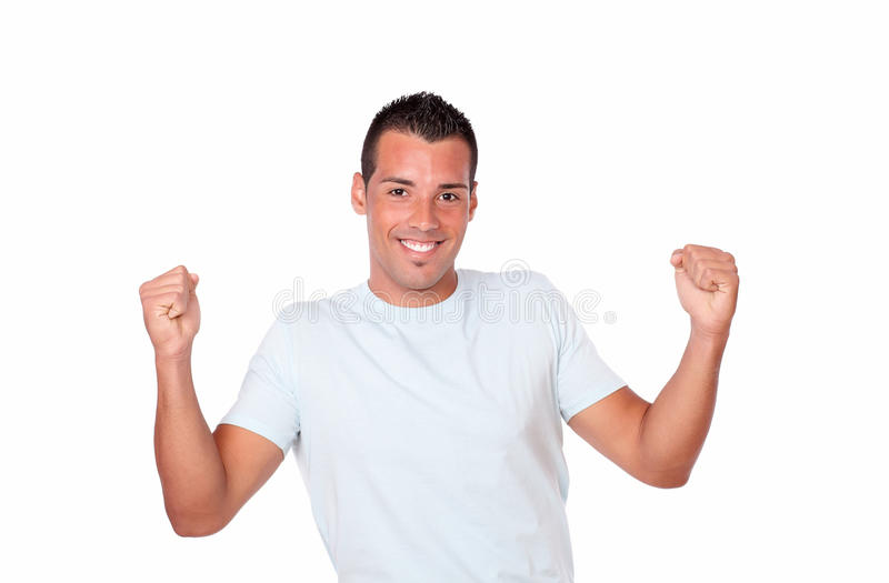 Gorgeous hispanic guy celebrating his victory. Portrait of a gorgeous hispanic guy celebrating his victory while standing and smiling at you on isolated studio royalty free stock photo