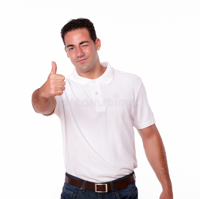 Gorgeous hispanic guy with ok sign. Portrait of a gorgeous hispanic guy with ok sign standing and smiling at you on isolated studio stock images