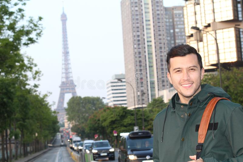 Gorgeous Hispanic man with Paris in the background stock images