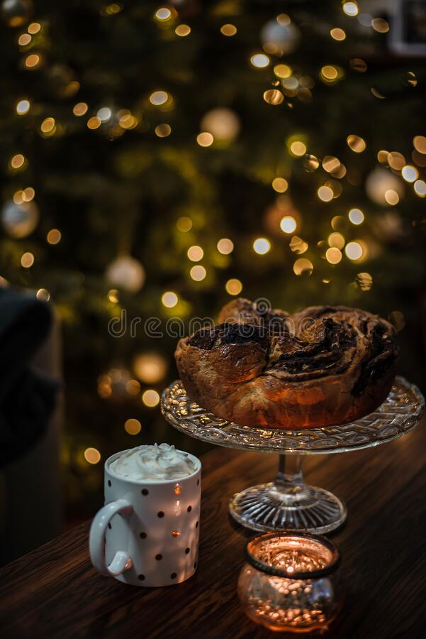 Gorgeous homemade chocolate wreath is a perfect christmas breakfast when combined with hot cocoa with whipped cream. royalty free stock photo