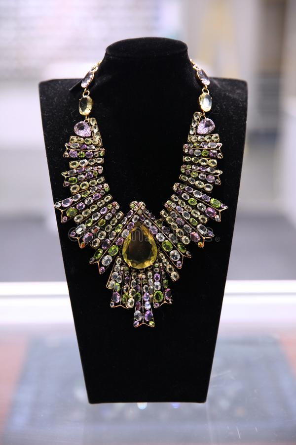Gorgeous huge vintage necklace with lots of colorful stones. On display royalty free stock photography