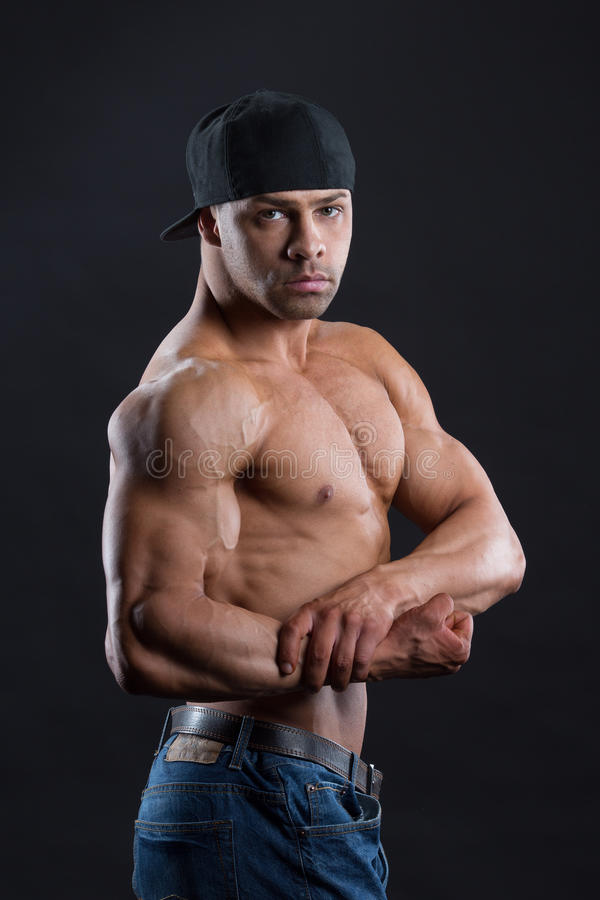 Gorgeous independent man shows his powerful strong body stock photography