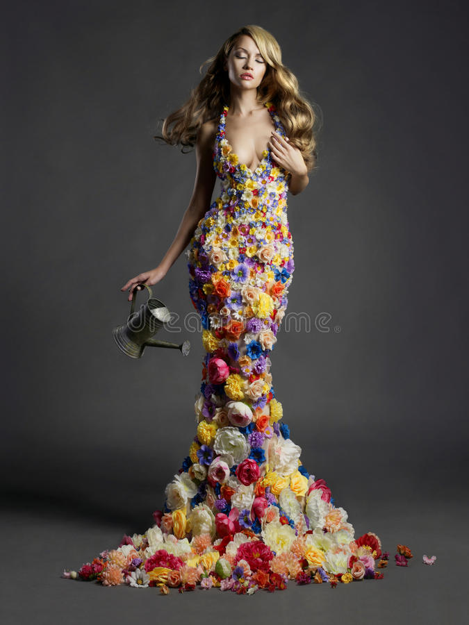 Gorgeous lady in dress of flowers royalty free stock photos
