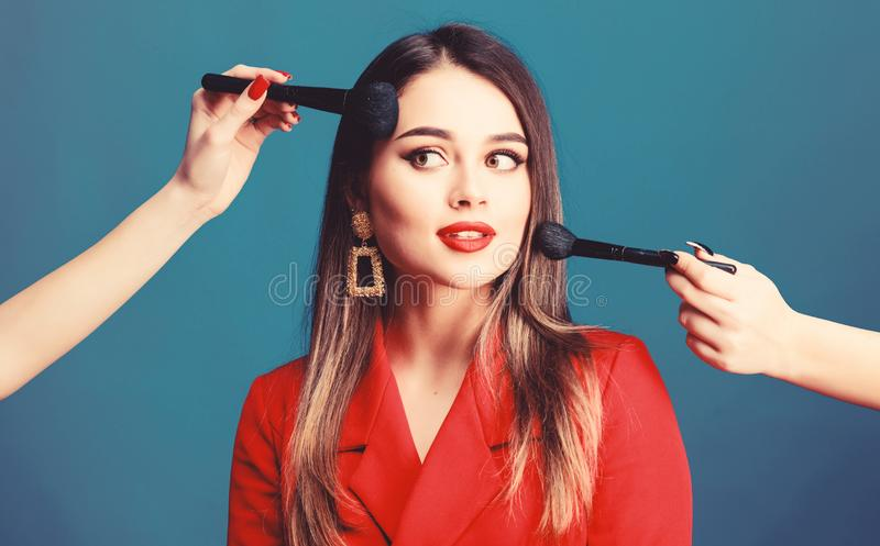 Gorgeous lady make up red lips. Skin care. Cosmetics concept. Beauty salon facial care. Pretty woman applying makeup stock image