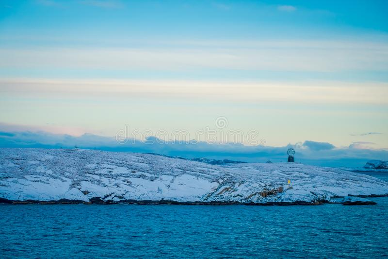 Gorgeous landscape of coastal scenes ofcoast covered with snow on Hurtigruten during voyage in a good weather. In Norway royalty free stock photos