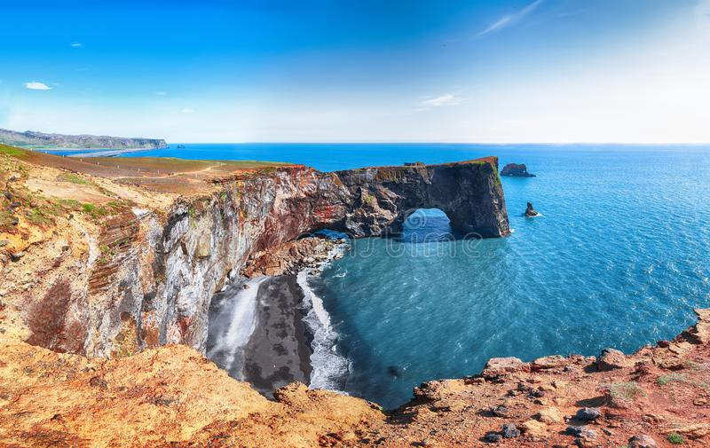 Gorgeous landscape with unique basalt arch on Dyrholaey Nature Reserve on Atlantic South Coast. Location: Dyrholaey cape, Vik I Myrdal village, Katla Geopark stock photo