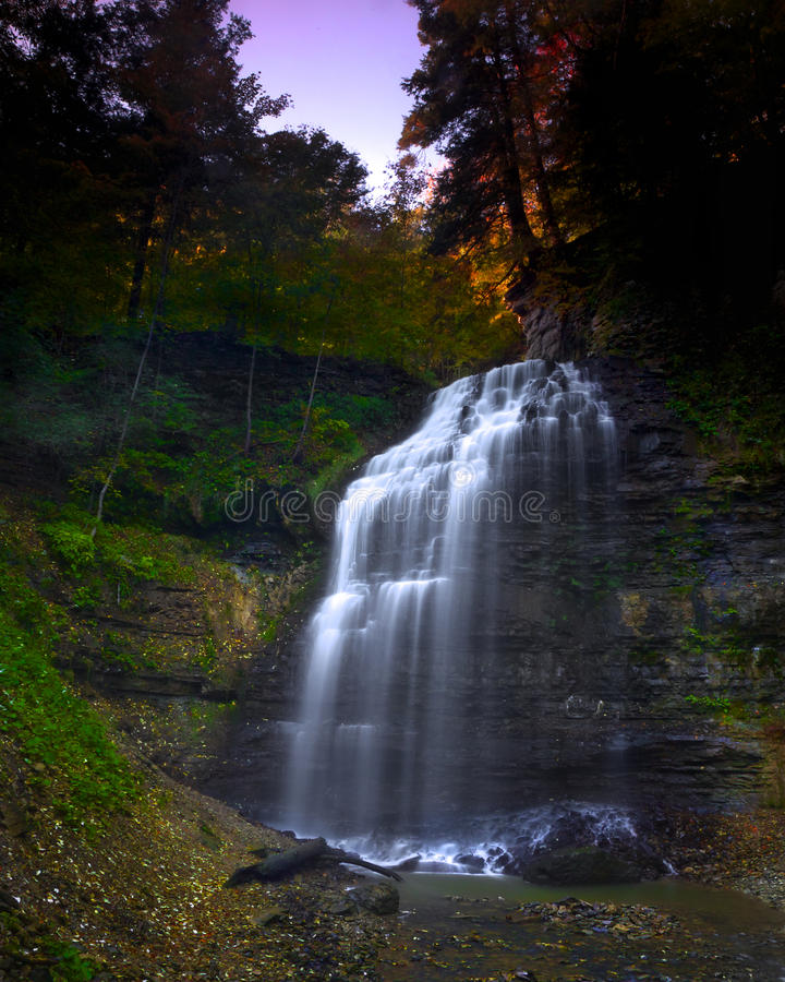 Gorgeous Light over Majestic Waterfall. Dawn breaking over Tiffany Falls in Ancaster, Ontario royalty free stock photos