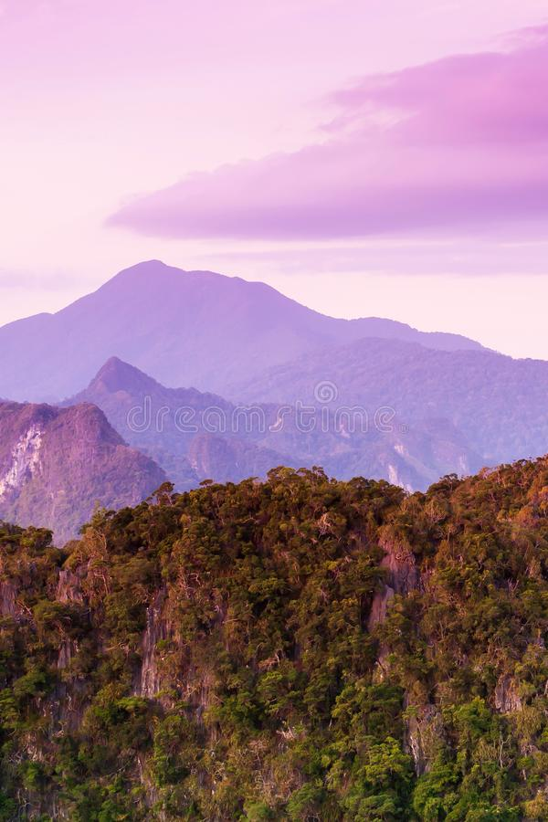 Gorgeous limestone mountains and beautiful clouds on summer dusk royalty free stock images