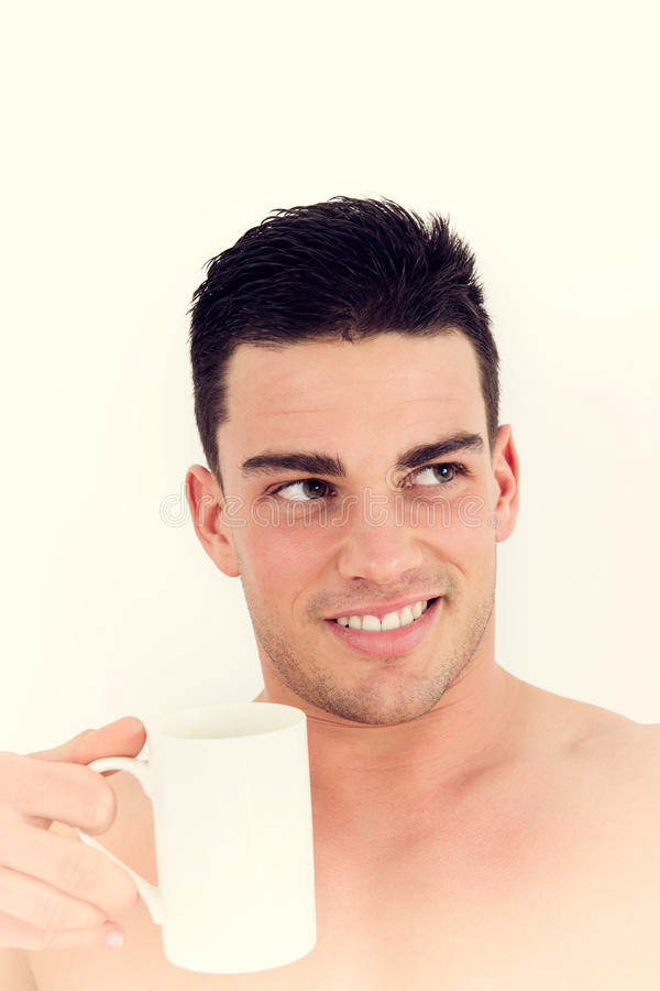 Gorgeous man holding a cup of coffee stock images