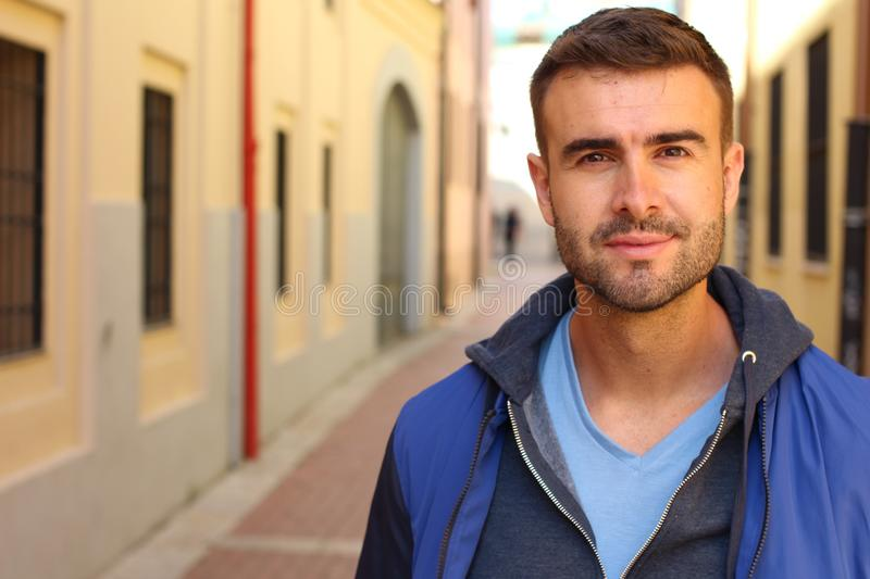 Gorgeous man looking at camera outdoors royalty free stock photo