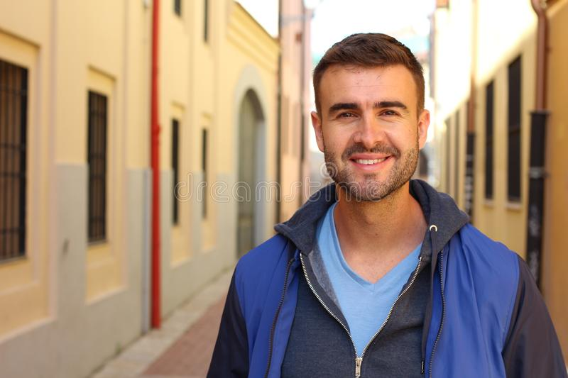 Gorgeous man looking at camera outdoors royalty free stock image