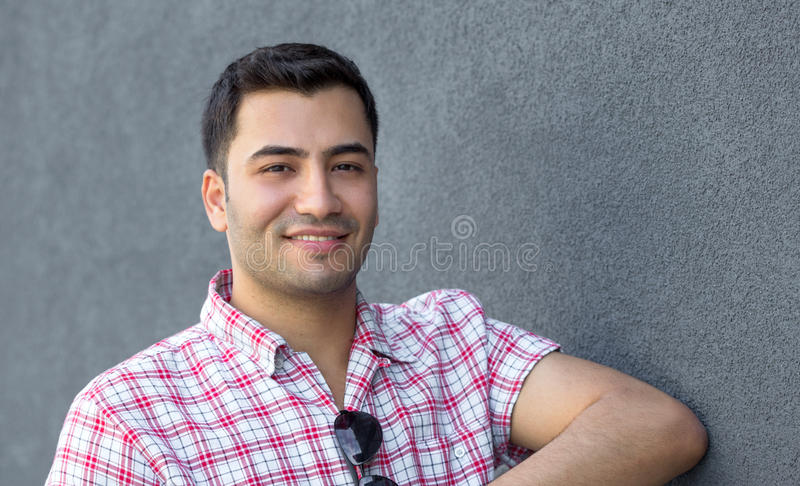 Gorgeous man. Portrait of a smile young man. Close up outside shot of happy gorgeous guy stock photo