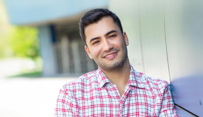 Gorgeous man. Portrait of a smiling young man. Close up outside shot of happy gorgeous guy stock photos