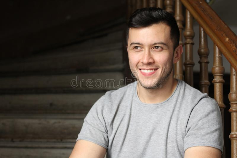 Gorgeous man smiling and looking away with copy space royalty free stock image