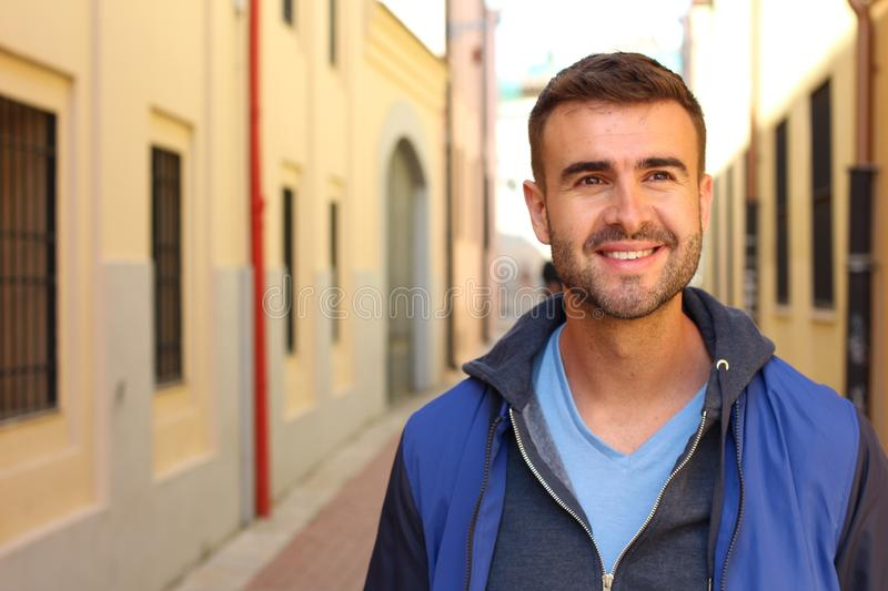 Gorgeous man in urban background royalty free stock photography