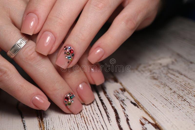 Gorgeous manicure, dark purple tender color nail polish, closeup photo stock photo