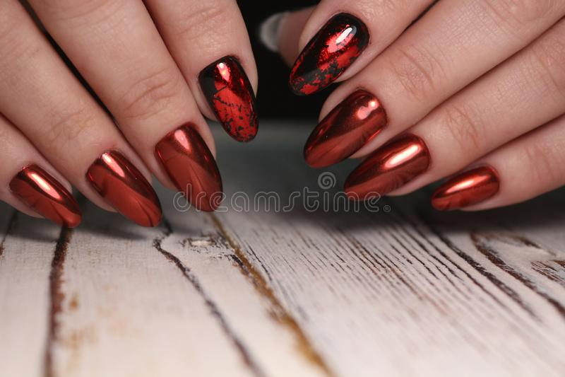 Gorgeous manicure, dark purple tender color nail polish, closeup photo stock photography