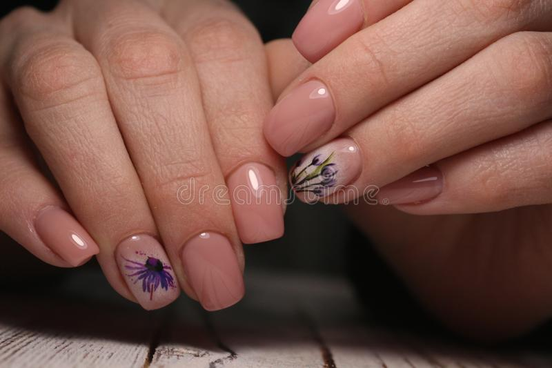 Gorgeous manicure, dark purple tender color nail polish, closeup photo stock images