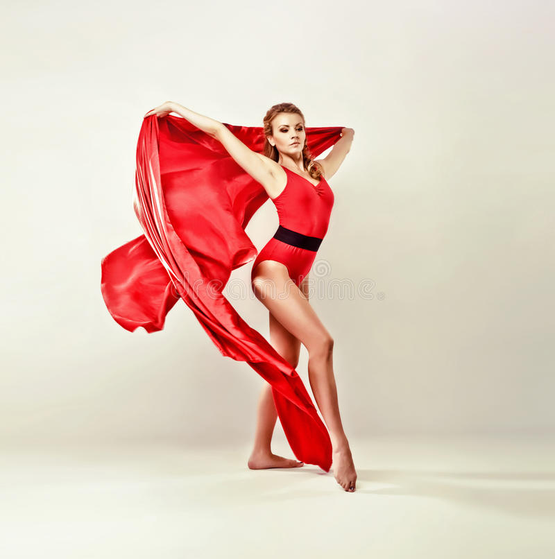 Gorgeous Model With Red Satin Cloth Stock Image