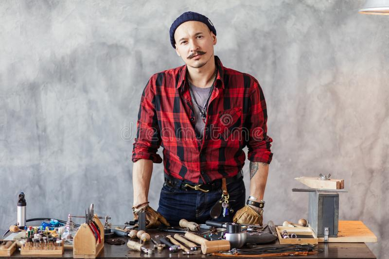 Gorgeous pleasant guy repaires your broken chains, earrings,. Watches stock images