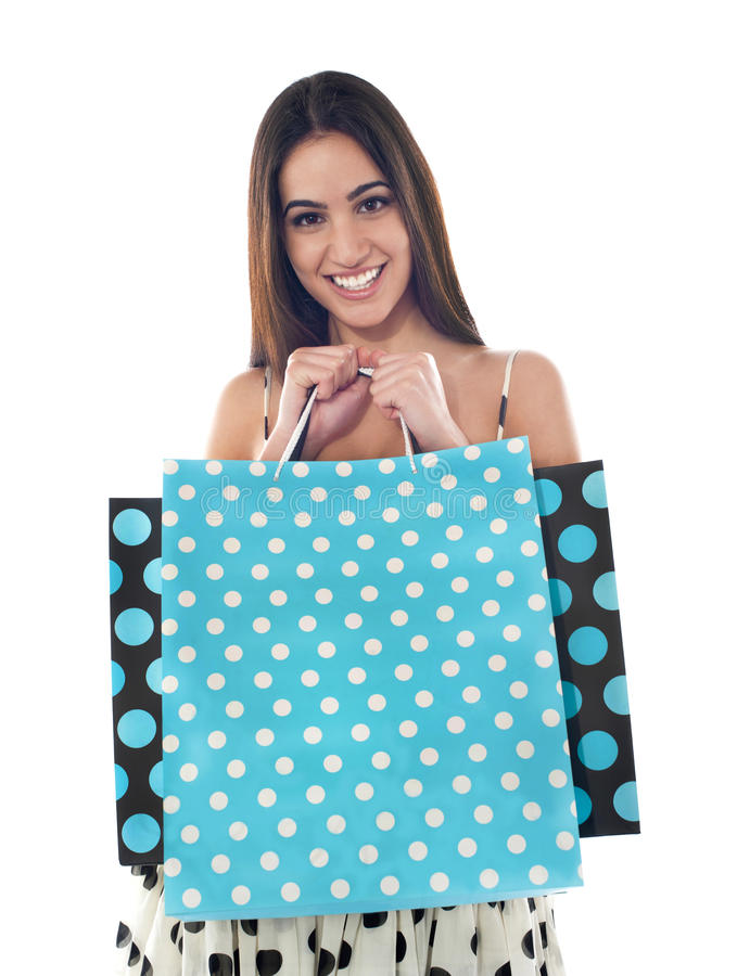 Gorgeous pretty girl holding shopping bags