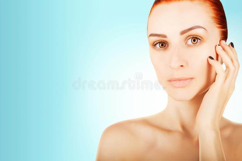 Gorgeous red haired woman portrait, blue gradient background royalty free stock photos