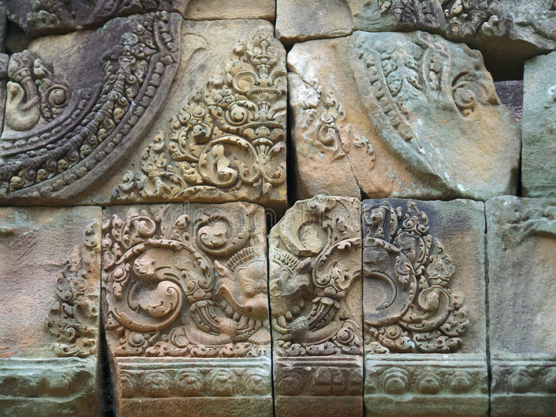 Gorgeous relief on the pediment of the ancient temple complex in Buriram, Thailand. Gorgeous relief on the pediment of Prasat Hin Muang Tam, the ancient temple royalty free stock photography