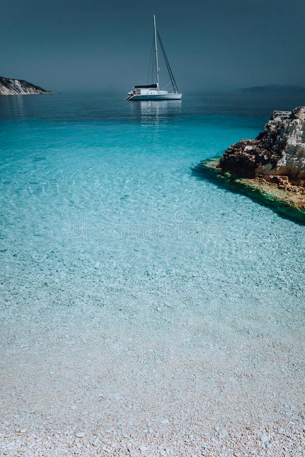 Gorgeous seascape with white yacht on calm water. Summer vacation holiday luxury travel romantic honeymooning concept stock image